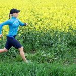 Woman running outdoors on spring